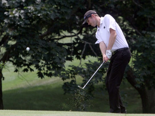 Kevin Duncan hits to the 7th green during the final