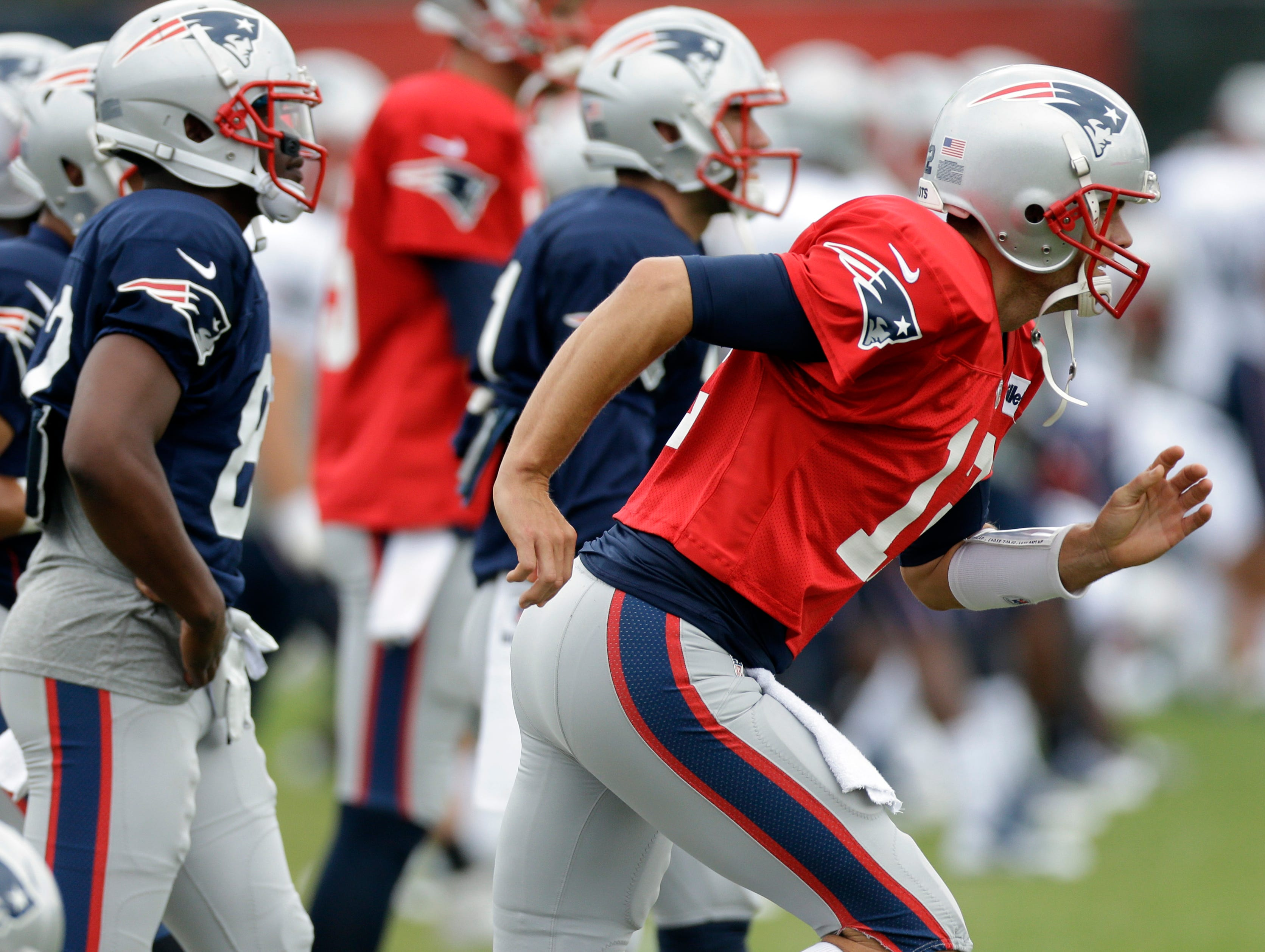 Patriots QB Tom Brady is on the run during a joint practice with the Eagles in Philadelphia on Aug. 7.