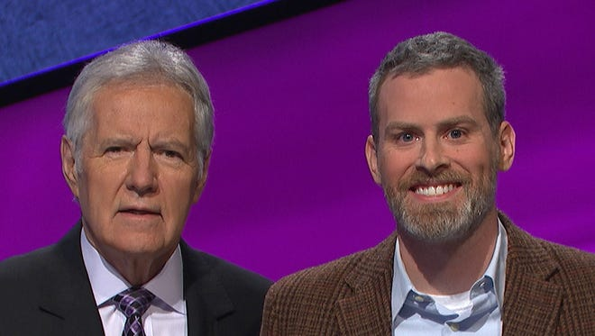 """York College professor Nicolas Anspach (right) poses next to """"Jeopardy!"""" host Alex Trebek. Anspach will appear as a contestant on the show on June 13."""