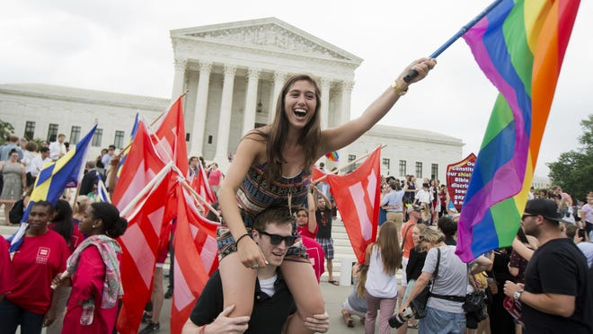 Sasha Altschuler of San Diego, Calif., joins the celebration outside the Supreme Court in Washington after the court declared Friday that same-sex couples have a right to marry anywhere in the United States.
