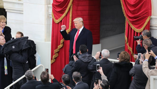 Donald Trump is introduced before being sworn in as the 45th president of the US.