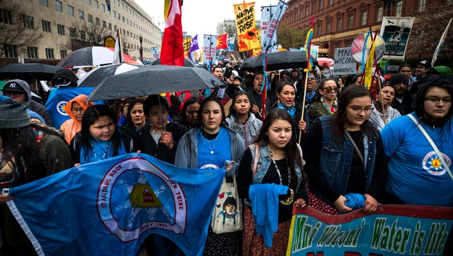Protestors rally against support for the Dakota Access pipeline during a march to the White House in Washington, DC.