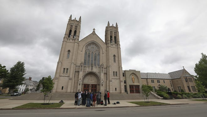 Mitchell Garabedian, a Boston attorney who has represented over 3,000 victims of clergy abuse, Robert Hoatson, former priest and founder of Road to Recovery, a victim's support organization, and James Faluszczak, survivor of abuse and former priest, hold a press conference on Diocese of Rochester priests accused of abuse outside Sacred Heart Cathedral on Flower City Park in Rochester Wednesday, June 6, 2018.