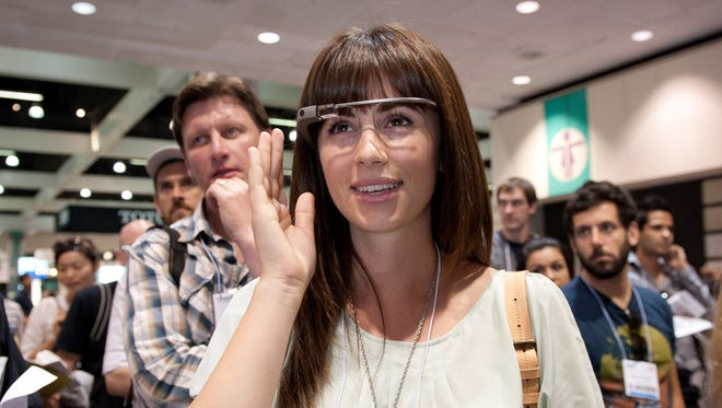 An attendee tries on Google Glass at the Dwell on Design conference.