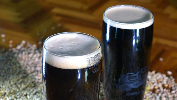 Tailgate Brewery's porter, left, and stout craft beers.