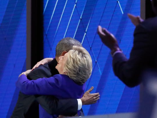 President Barack Obama hugs Democratic Presidential candidate Hillary Clinton as she take the stage at the conclusion of his speech during the third day of the Democratic National Convention in Philadelphia, Wednesday, July 27, 2016.