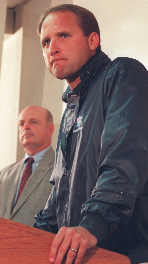 October 21, 1996. Cincinnati Bengals President and General Manager Mike Brown addresses the media during a press conference at Spinney Field Monday where Brown, left, announced that Head Coach Dave Shula, right, was stepping down as coach and is being replaced by offensive coordinator and former New York Jets head coach Bruce Coslet.