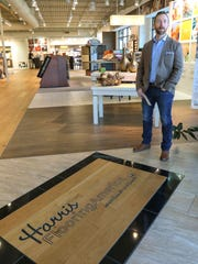 Scott Junkin of Harris Flooring America stands by the front door of the store at 51 Civic Center Blvd. Extension, near the Anderson Mall.