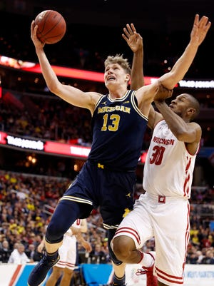 Michigan forward Moe Wagner shoots over Wisconsin forward Vitto Brown during U-M's 71-56 win in the Big Ten championship game, Sunday, March 12, 2017, in Washington.