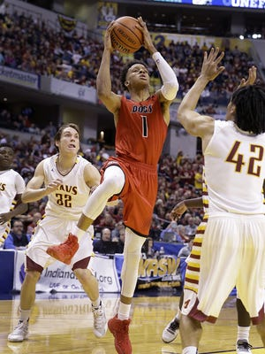 New Albany's Romeo Langford (1) drives on McCutcheon's Billy Loft (42) during the IHSAA Class 4A Boys Basketball State Final game March 26, 2016.