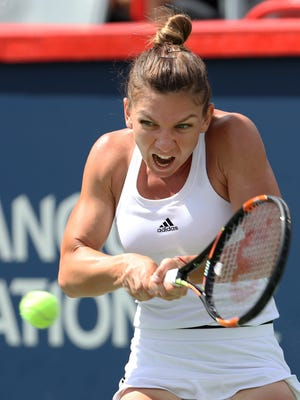 Simona Halep of Romania hits a shot against Angelique Kerber (not pictured) of Germany on day six of the Rogers Cup tennis tournament at Uniprix Stadium.