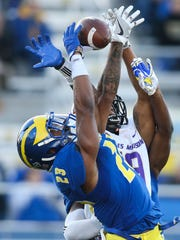Delaware safety Nasir Adderley breaks up a pass in last year's 20-10 loss to top-ranked, defending NCAA champ James Madison at Delaware Stadium.