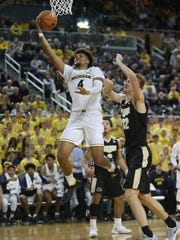 Michigan forward Isaiah Livers scores against Purdue