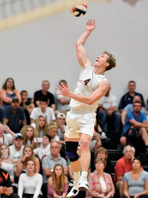 Northeastern's Wyatt Hughes spikes the ball against Central York in the fourth set of a YAIAA boys' volleyball match Thursday, May 10, 2018, at Northeastern. Northeastern defeated Central 3-2 (20-25, 21-25, 25-16, 25-14, 15-7) to win the regular-season YAIAA title.