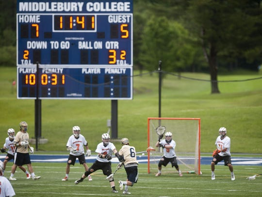 Essex's Joe Galati (6) fires a shot at Middlebury goalie Nathan Lalonde during the second half of Tuesday's Division I boys lacrosse semifinal at Middlebury College. The Tigers won 11-10 in overtime to advance to their first championship game since 2005.