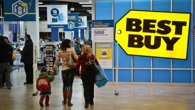 File photo taken in 2013 shows shoppers entering a  Best Buy store in New York City.