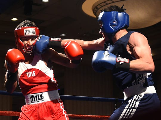 Nevada's Nate Strother, right, lands a blow against UCLA's Gabriel Samuels during the 2017 NCBA Western Regional semifinals at the Eldorado Hotel & Casino in Reno on March 18.