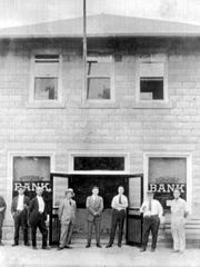 Building as the Seminole Bank in 1923 with from left:  Harry M. Speedy, Arthur T. Hogarth, E. J. Ricou-V.Pres, D. W. C. Ruff-Director, John E. Taylor-Pres, Andrew R. Wallace-cashier, H. Edwin Rogers, and A. L. (Roy) Lane.