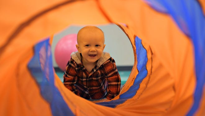 Luke Bott, 10 months, looks through a tube during Baby Gym at Foothills Activity Center on Monday, April 3, 2017. Baby Gym is among the offerings provided through the Fort Collins Recreator program. Summer 2018 registration opened May 10.