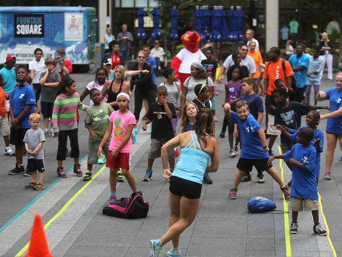 Kids participate in a fitness program called Born to Move on Fountain Square. The YMCA of Greater Cincinnati unveiled their exciting new fitness program for children called Born to Move, and held a party this afternoon on Fountain Square.  The program utilizes energizing music, games, dance, magic, and the power of imagination to encourage kids to get active. The YMCA of Greater Cincinnati is the first local fitness facility to offer the Born to Move program; classes will be available at several Cincinnati and Northern Kentucky YMCA branch facilities this fall, and in many YMCA after school programs.