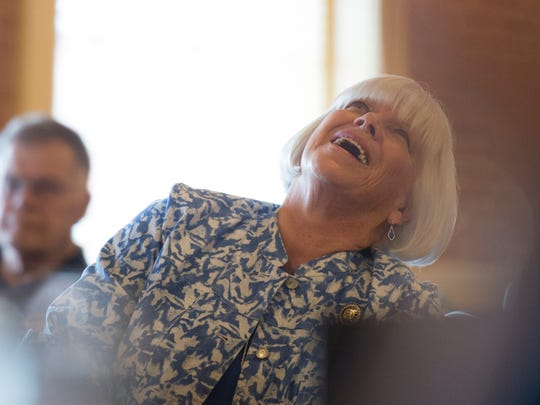 Rep. Mauree Gingrich laughs at a joke as the Community