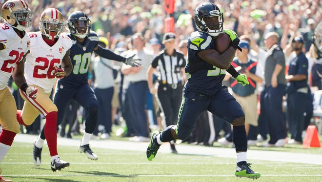 Seattle Seahawks running back Christine Michael (32) scores a touchdown during the first quarter against the San Francisco 49ers at CenturyLink Field.