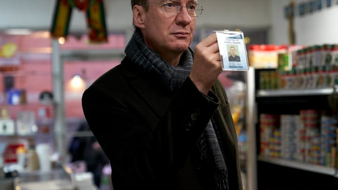 Jim (David Thewlis), a food inspector, flashes his badge at a possible violator.