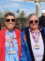 Senior swimmers Pamela Gulbrandson, left, and Yenny van Dinter sport gold medals collected at the Arizona State Senior Games held Feb. 26, in Chandler. The Deming duo are preparing for the Dona Ana County Senior Swim Meet to be held on March 18 in Las Cruces.