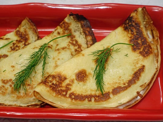 Clatite, as enjoyed in the Sweet family, are crepes filled with cottage cheese and generous amounts of fresh dill.