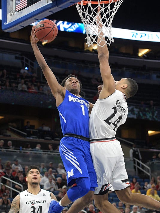 Memphis guard Jamal Johnson (1) goes up for a shot between Cincinnati guard Jarron Cumberland (34) and forward Kyle Washington (24) during the first half of an NCAA college basketball game in the semifinals at the American Athletic Conference tournament Saturday, March 10, 2018, in Orlando, Fla. Cincinnati won 70-60. (AP Photo/Phelan M. Ebenhack)