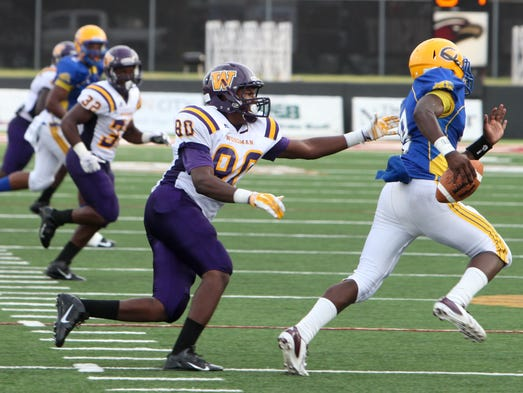 Wossman plays Carroll on Friday during the Capital One Bank Jamboree at ULM'?s Malone Stadium.