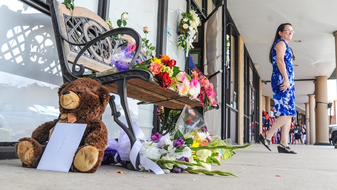 Flowers and other items are placed at a memorial at the front door to the Farese Family Dental office in Oxford, Miss., Monday, Aug. 15, 2016. Dentists Dr. Jason Farese and his wife Dr. Lea Farese, as well as Dr. Austin Poole and his wife Angie Poole and Dr. Michael Perry and his wife Kim Perry were killed in a plane crash outside of Tuscaloosa, Ala. , on Sunday, Aug. 14, 2016.