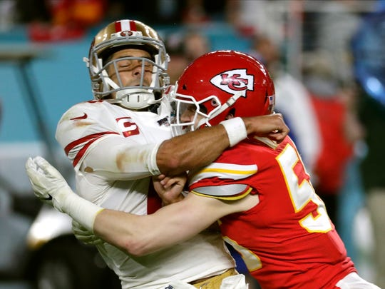 Former Hawkeye linebacker Ben Niemann, right, had a big role for the Kansas City Chiefs in their Super Bowl win against the San Francisco 49ers.