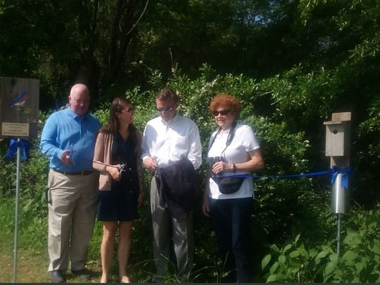Fred Robertson with the Tennessee Blue Bird Society, Crystal Warren with the Collierville Environmental Commission, Collierville Alderman John Stamps and Sheila Bentley, also with the environmental commission, cut the ribbon on Collierville's newest bluebird house trail at W.C. Johnson Park.