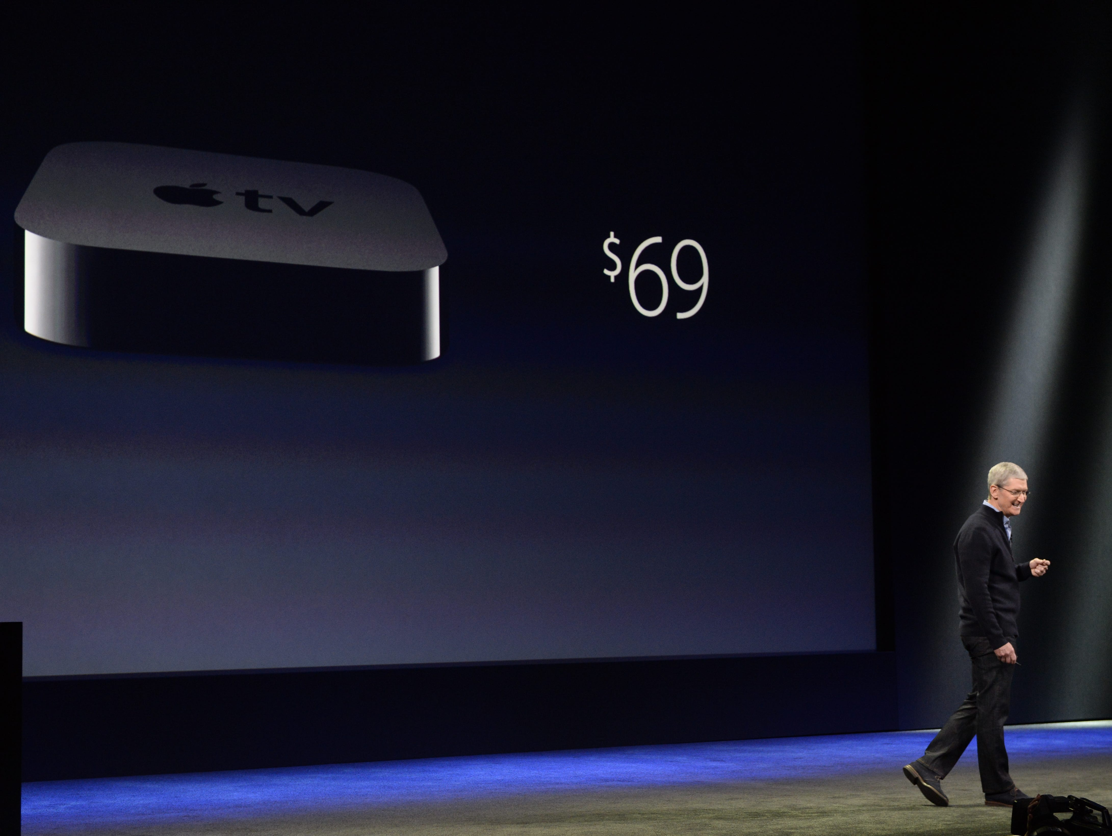 Tim Cook, CEO of Apple, announces a price drop on Apple TV to $69 on March 9, 2015 at the Yerba Center for Performing Arts in San Francisco.
