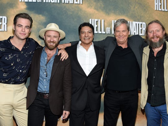"Actors Chris Pine (from left), Ben Foster, Gil Birmingham, Jeff Bridges and director David Mackenzie arrive at the Los Angeles red carpet screening of  ""Hell or High Water"" on Aug. 10 in Hollywood, California."