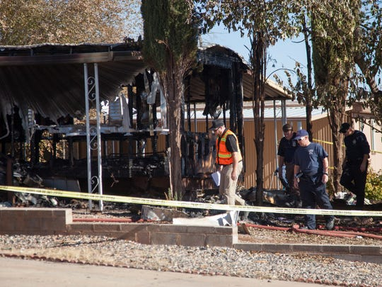 Members of the St. George Fire Department and the Utah State Fire Marshal inspect the remnants of a fatal house fire Tuesday, Dec. 6, 2016.