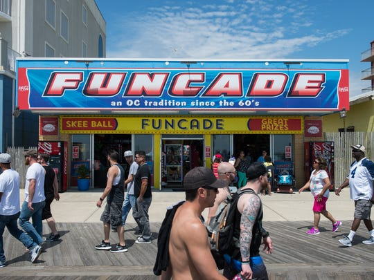 Passersby walk past Funcade on the boardwalk in Ocean City on Saturday, May 27, 2017.