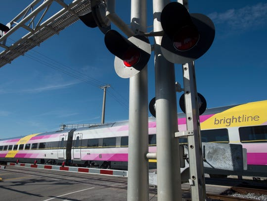 Brightline trains run between West Palm Beach and Fort Lauderdale in this file photo taken Thursday, Jan. 18, 2018, in Boynton Beach.