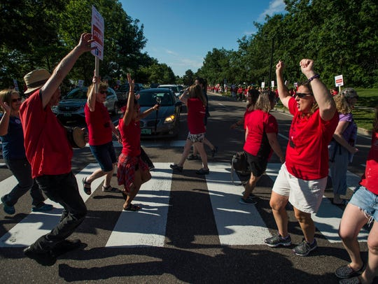 Nurses dance across the crosswalk during red light