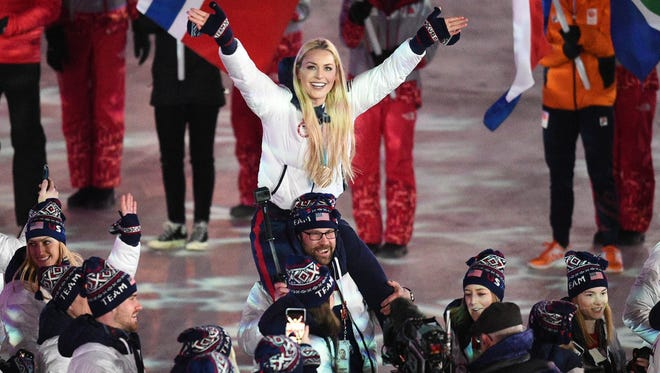 Lindsey Vonn got a lift at the closing ceremony.