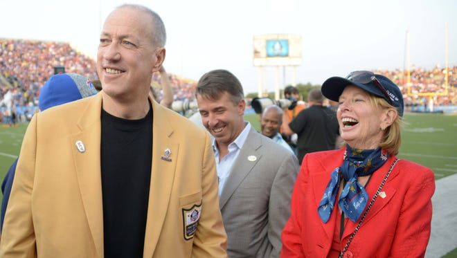Aug 3, 2014; Canton, OH, USA; Jim Kelly (left), Buffalo Bills president Russ Brandon (center) and Mary Wilson at the 2014 Hall of Fame game at Fawcett Stadium. Wilson is wife of late Buffalo Bills owner Ralph Wilson (not pictured). Mandatory Credit: Kirby Lee-USA TODAY Sports ORG XMIT: USATSI-179642 ORIG FILE ID:  20140803_ajl_al2_269.JPG