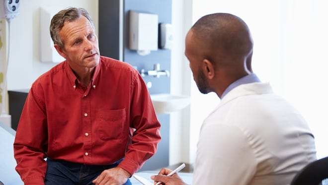 A man discusses feelings of depression with his doctor. Anytime symptoms of depression begin to affect work, leisure or family, it's important to reach out to a professional for help.