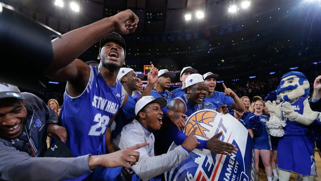 Seton Hall's Myles Carter (23) celebrates with teammates after an NCAA college basketball game against Villanova during the Big East men's tournament Saturday, March 12, 2016, in New York. Seton Hall won 69-67. (AP Photo/Frank Franklin II)