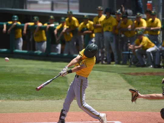 Bishop Manogue's Calvin Bailey (7) hits a home run on the first pitch of the game while taking on Basic High School (Las Vegas) during the NIAA State Baseball Championships in Reno on May 18, 2018.
