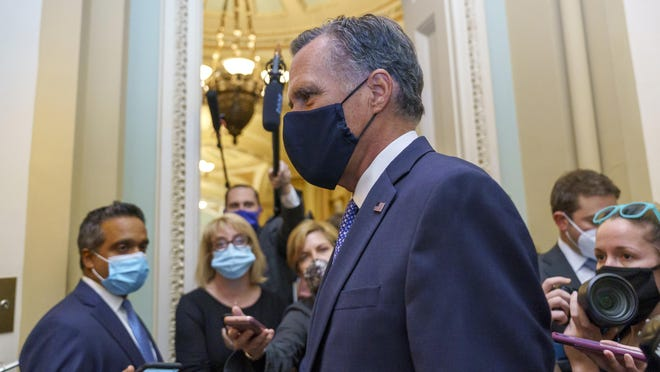 Sen. Mitt Romney, R-Utah, tries to avoid reporters as he leaves the Senate Chamber following a vote, at the Capitol in Washington, Monday, Sept. 21, 2020. Romney is one of four Republicans who could oppose a vote on a replacement for the late Justice Ruth Bader Ginsburg prior to Election Day.