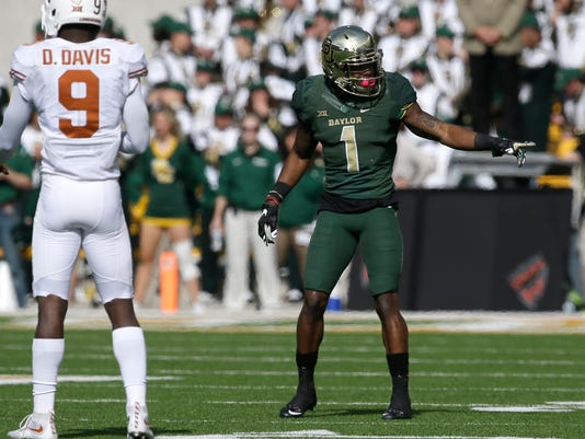 Baylor wide receiver Corey Coleman (1) lines up against Texas cornerback Davante Davis (9) during the first half of an NCAA college football game Saturday, Dec. 5, 2015, in Waco, Texas. The Baylor junior receiver appears to have decided to bypass his senior season with No. 12 Baylor for early entry into the NFL draft. (AP Photo/LM Otero)