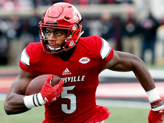 Louisville's Seth Dawkins returns a kickoff against