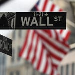 A Wall Street road sign near the New York Stock Exchange building in New York.