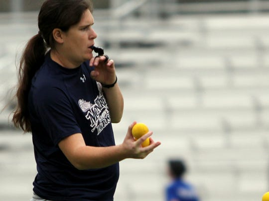 Katy Ferguson coaches her players during drills recently in one of the Cavaliers' last practices before opening their second season.
